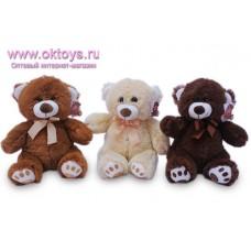 Медведь с атласным бантом - музыкальная игрушка