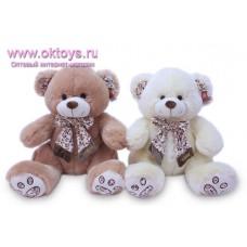 Медведь с бантом в цветочек - музыкальная игрушка
