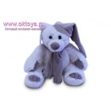 Медведь Семен в коричневом колпаке и шарфе