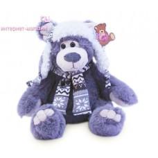 Серый медведь Семен в белой шапке