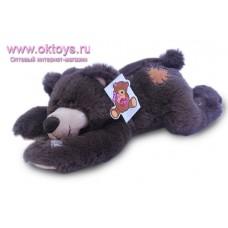 Бурый медведь Семен лежащий
